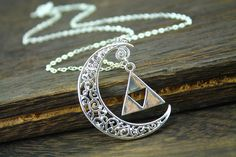 the legend of zelda jewelry crescent necklace   { Details: } - Delicate necklace, not allergic.  - 24 chain length  - The pendant is made of copper