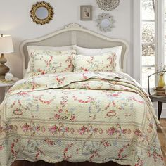 Add a feminine touch to your bedroom with this delicate floral quilt set. Both the cover and fill are made from pure cotton, so they're machine washable as well as comfortable. For your convenience, this set comes complete with quilt and two shams.