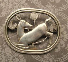 Antique Denmark Sterling Brooch By Georg Jensen Deer Pin Number 256 This is a beautiful antique sterling silver brooch by Georg Jensen # 256