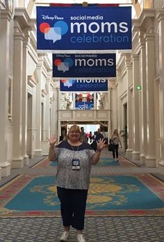 Disney SMMC and I am in the iconic hall of banners at Disney's Yacht Club Resort Convention Center, wearing my comfy #Penningtons ensemble. :-) #DisneySMMC #DreamComeTrue