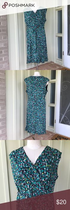 "Geometric Print Faux Wrap Dress with Flounce Hem Super cute dress for the office or church. Faux wrap style flatters the waist and prevents any wardrobe malfunctions. Flounce hem is flirty and fun and fabric belt adds definition. Hits just slightly below knee (I'm 5'7"").  Size 20, true to size. glamour Dresses"