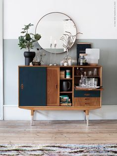 A Simple Round IKEA Mirror Looks Deceptively Elegant Paired With A Vintage  Wooden Sideboard. The Secret To Mastering This Mix Is To Style The  Countertop ...
