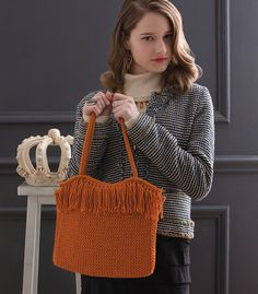 You will find the book, 60 Quick Luxury Knits, on display.