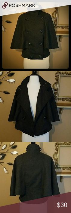 Charcoal gray cape jacket Everyone needs a cape this fall/winter! This is a great transition piece. Wear with a button down when it's not too cold or wear with thick sweater when it starts to snow. Button and snap closures at neck. Wool blend. taxi Jackets & Coats Capes