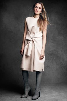 """Giaia reposi""""I think women look best when they're not overdressed. Ease is chic.""""  Céline dress, $5,500, and boots, $2,890, 305-866-1888. Repossi rings, Barneys New York, 888-8-BARNEYS.   - HarpersBAZAAR.com"""