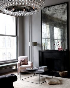 Harriet Mawell / Andrew Corrie {black, gray and white living room} by recent settlers, via Flickr.. NEAT MIRROR