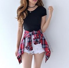 A black crop sleeve shirt with a pair of white shorts and a flannel wrapped above the waist.