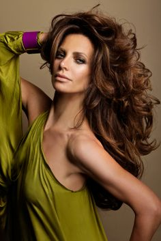 Long brunette with volumeized big loose curls hairstyle