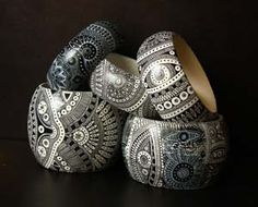 Absolutely gorgeous -- acrylic, pen & acrylic lacquer on wooden bracelets: http://hiero.ru/2229355