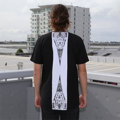 Black quilted tshirt, contrast back panel with zip and ta moko maori artwork.