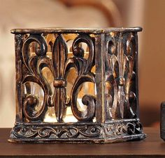 Fleur de Lis Candle Holder. Log on to www.annieks.com to see more items like this.