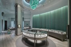 Tiffany and Co. retail store interior. Love the blue chandelier!!!