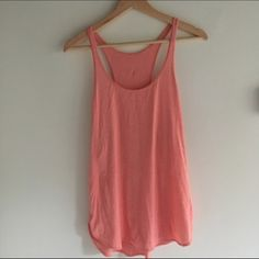 Lululemon tank Beautiful coral tank from Lululemon! Trendy split hem, subtle stripes, and iconic reflective logo on back. Cute enough to wear out and about, not just at the gym.❌trades. offers. lululemon athletica Tops Tank Tops