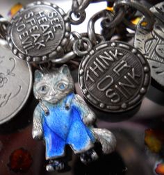 Antique Sterling Kitten Cat in Blue Enamel Dungarees and Think Or Sink Charm