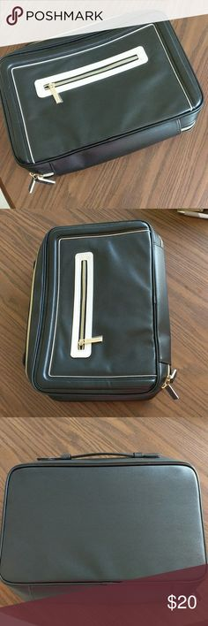 Estee Lauder Cosmetic Case Estee Lauder Cosmetic Case is Black with a white pocket in the front, handle on top. It measures 10.5 inches tall, 13.5 inches long, and 3 inches wide when zipped but can expand. This case is brand new never been used! Estee Lauder Makeup