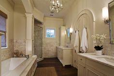 bathrooms - arched doors twin ivory single bathroom vanity marble countertop rectangular pivot mirrors shower tub sisal rug  Stunning master