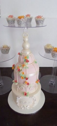 Birdcage wedding cake with rise cupcakes. Created by Villa Chateau