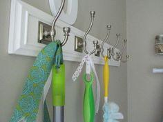 Cute way to hang brooms/mops