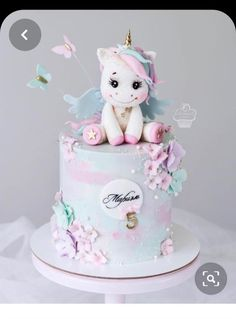 Cute unicorn cake, unicorn and pastel butterflies Pretty Cakes, Cute Cakes, Beautiful Cakes, Amazing Cakes, Baby First Birthday Cake, Cute Birthday Cakes, Fondant Cakes, Cupcake Cakes, Unicorn Cake Topper