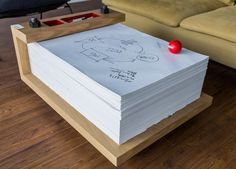 A paper table for taking notes during meetings! Now that's different.