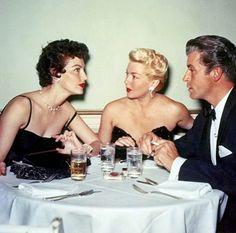 """franciegummstarstruck: """"Ava Gardner, Lana Turner, and Fernando Lamas pictured at a party in 1952. """""""