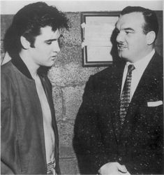 """Elvis and  wrestler """"Whipper"""" Billy Watson - Apr. 2, 1957 Photo courtesy Bill E. Burk's """"Elvis in Canada""""  backstage at the Maple Leaf Gardens, Toronto ONT -   Elvis' first set included two unreleased covers, Charlie Gracie's """"Butterfly"""" and Smiley Lewis' """"One Night."""" Presley had waxed the Lewis number in February, it would be issued by RCA in October 1958. Billy Watson was a famous Canadian professional wrestler and part of Elvis' security team in Toronto."""