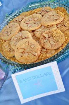 """mermaid party food sand dollars! Use a sugar cookie, top with almonds, and sprinkle brown sugar and graham crackers for """"sandy"""" appearance!"""