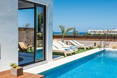 fos villa in Chania is brand new designed villa for up to 10 persons with pool.Fosvilla is located at the entrance of Galatas village distance from the centre of Chania city and enjoys views of the Mediterranean sea and Chania town. Mediterranean Sea, Pool Houses, Crete, Pools, Entrance, Villa, Vacation, Outdoor Decor, Design