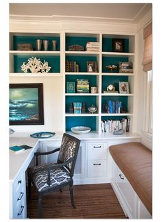 Painted back wall of office shelving or accented wall color before shelving - could also use individually wallpapered pieces of cardboard set into the backs of the shelves - much easier to change out colors/patterns, rather than painting a whole wall each time you want to change the accent color.