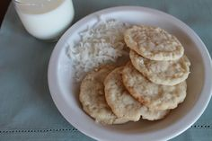 Coconut Sugar Cookies. Made with sugar, butter, flaked coconut, vanilla, flour, bakgin soda, and salt.