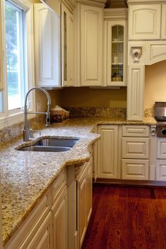 Example: Golden Beach Granite, due to being more visually busy I think the walls will need to read more neutral.