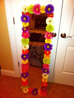 DIY mirror. So easy to make!    Walmart full length mirror & artificial flowers from Michaels!