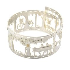 """JEN RICKETTS-UK Silver Summer Sunday Afternoon Bangle """"Jen uses her hand drawn sketches as a template for cutting each design out by hand. Making it simple to design to specific requirements and taylor designs to each individual"""""""