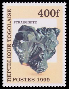 Pyrargirite , Dark red silver ore or Ruby silver ,  is a sulfosalt mineral consisting of silver sulfantimonide.  Postage stamp from Togo, 1999