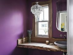 A live edge wood sink and a mini chandelier boost this bathroom's design factor. Source: Windermere Real Estate