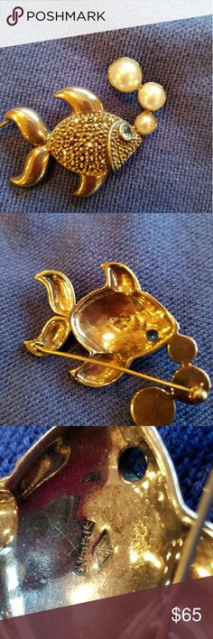 Judith Jack Signed Sterling Silver Fish Brooch/Pin This pretty fish has shiny marcasites and a blue topaz eye. The fish is blowing bubbles made of simulated pearls. The back is stamped .925 and has a Judith Jack makers mark. This brooch is in perfect condition with c clasp. It is really cute on a sweater. It looks like the fish is floating. Judith Jack is classic and never goes out of style! Judith Jack  Jewelry Brooches