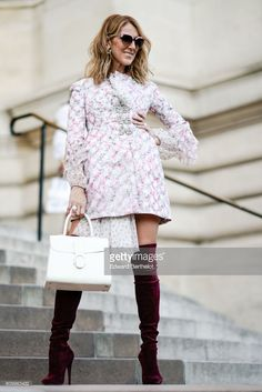 Celine Dion wears sunglasses, a dress with embroidered features and lace, a white bag, and purple thigh high velvet boots, outside the Giambattista Valli show, during Paris Fashion Week - Haute Couture Fall/Winter 2017-2018, on July 3, 2017 in Paris, France.