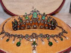 1870-1890 tiara and necklace wedding set. 14kt gold and sterling silver, Austrian hallmarks on the necklace. Rose  cut diamonds. Necklace contains baroque pearls along with faceted and cabochon emeralds; faceted emeralds only in the tiara. Original fitted box.