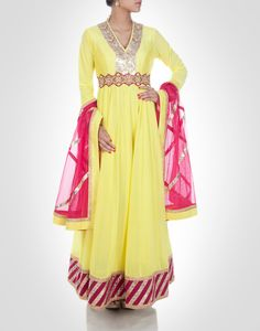 Yellow georgette anarkali with contrasting metallic tone floral work. Available in more colours. Shop Now: www.kimaya.in