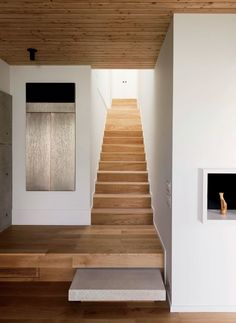 White-oak stairs connect the first-floor living spaces with the upstairs sleeping areas.