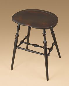 Windsor Stool in a Antiqued Black over Red Finish.