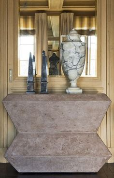 Dark marble obelisks in contrast to the white marble classical urn! Jean Louis Deniot