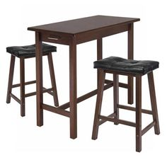 Kitchen Island Table w/ 2 Cushion Saddle Seat Stools - Winsome Wood your kitchen with this Breakfast Table and Cushion Stools. Table features a drawer at each end and finished in solid wood with Antique Walnut Finish.