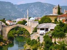 """Developed in the 15th and 16th centuries as an Ottoman frontier town, historic Mostar is famed for its melange of pre-Ottoman, Mediterranean and European architecture — and for the Stari Most (""""Old Bridge"""") for which it takes its name."""