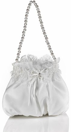 (One Size, White) This handmade Couture purse is a one of a kind in its design and style! This purse is made of a soft Satin accented at the top with Chantilly lace trim. The front of the purse is adorned with a dainty Satin ribbon bow complemented with a silver metal cross that delicately dangles from a shimmering crystal accent. The beautiful hand strap is made of large white pearls and clear contrasting beads. This purse it the perfect size to carry a few special items and a great…