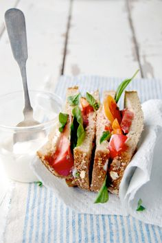 heirloom tomato, basil, and mayo sandwiches.