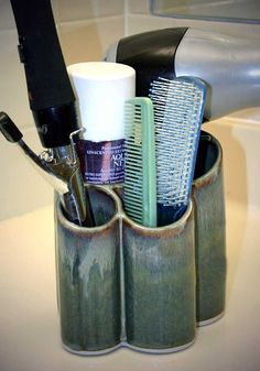 Hairdryer Holder Bay Pottery mixes clay and lead-free glazes from recipes formulated over many years. Bay's unique functional designs are high fired to 2300 degrees F, making them sturdy, dense, oven and dishwasher proof. These pieces are up-fired through a twelve hour process to achieve the beautiful reduction glazes for which Bay Pottery is known. Glaze option available. $18