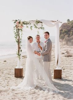 beach wedding with DIY arch