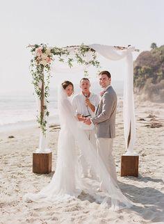 beach wedding with DIY arch
