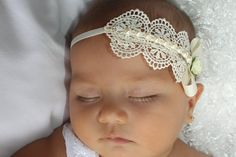 Baptism Headpiece, Ivory Headband, Lace Headband, Baby Headband, Infant Headbands, Newborn Headband, Christening Headband, Ivory Headpiece  This Spectacular Ivory Venice Lace Headband features a Bow, Flower, and Pearls. The bow and Venice Lace are felt backed for comfort and sits on top of a soft matching elastic headband.  All my products are designed to make your baby look beautiful while feeling really comfortable.  My Baby Headbands and Baby Barefoot Sandals come displayed on a printed…